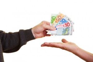Hand handing over Euro banknotes to other hand
